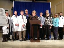 March 20, 2013 Press Conference to Accept Federal Funds. Left to right:  Lani Graham, MD, MPH, Steve Diaz, MD, FACEP, Joel Kase, DO, Immediate Past President, Maine Osteopathic Association, Dieter Kreckel, MD, President, Maine Medical Association, Sen. Geoffrey Gratwick, MD, Rep. Linda Sanborn, MD, Rep. Jane Pringle, MD, Kenneth Christian, MD, Rep. Ann Dorney, MD, Rep. Anne Graham, PNP, and Kirsten Thomsen, PA.