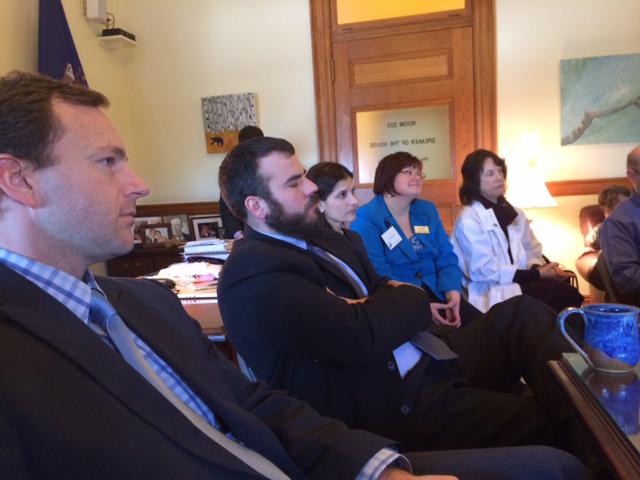 House Speaker Mark Eves listens to the doctors' concerns.