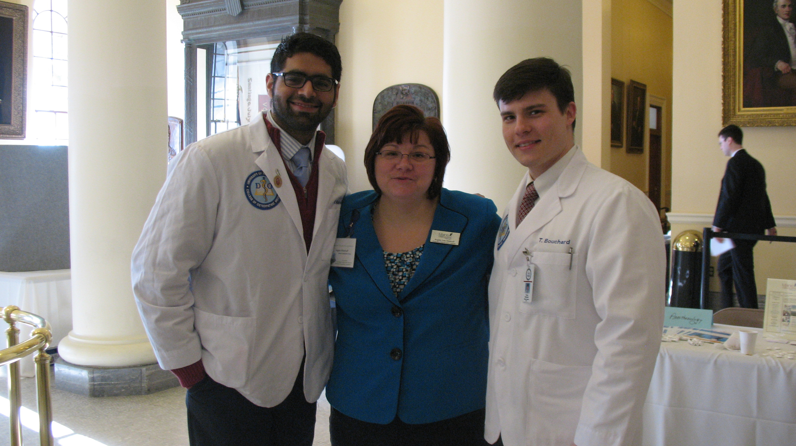 Angela Westhoff, Executive Director, Maine Osteopathic Association, with two UNECOM students.