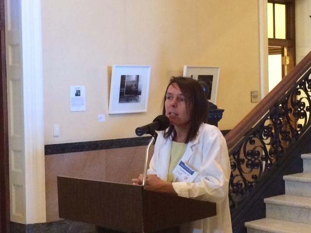 Lisa Ryan, DO, MMA President, addressing physicians.